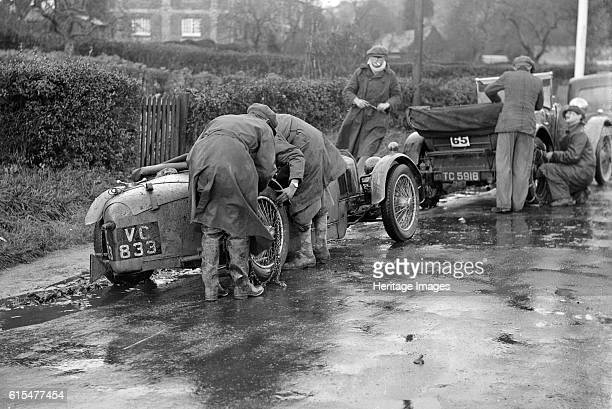 Attaching snow chains to JE Lancaster's Riley Brooklands during the InterVarsity Trial 1930 Riley Brooklands 2 seater sports 1929 1089 cc Vehicle Reg...
