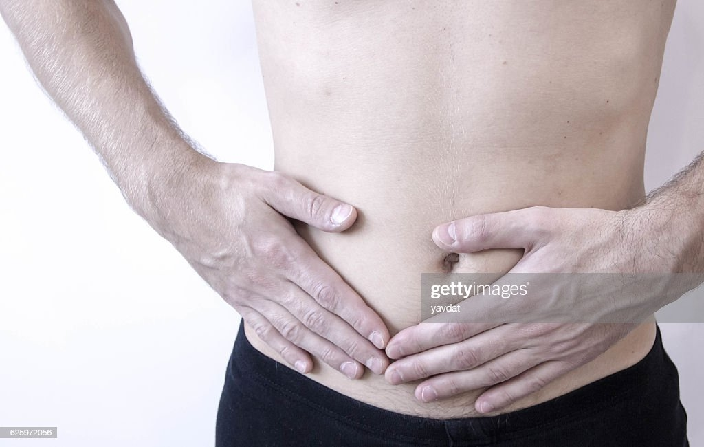 Attack of appendicitis. Pain in the right side. : Stock Photo