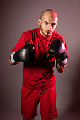 attacked boxer black gloves red shorts