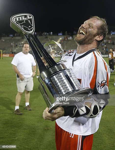 Attacker John Grant Jr #24 of the Denver Outlaws celebrates with the Steinfeld Trophy and the Game MVP trophy after winning the 2014 Major League...