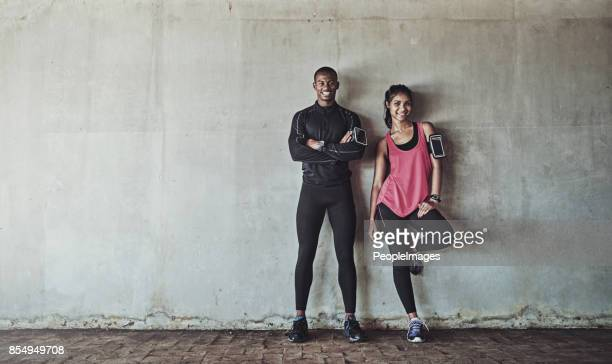 attaining and maintaining their fitness goals together - sportswear stock pictures, royalty-free photos & images