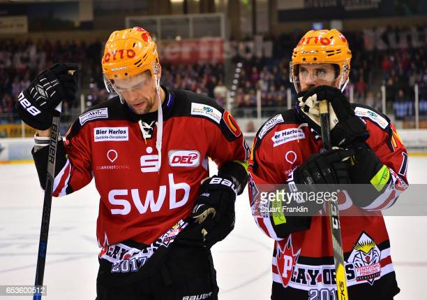 Atte Pentikainen and Brook Hooton of Bremerhaven look dejected after the fourth leg quater final playoff match between Fischtown Pinguins and EHC Red...