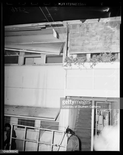Attempt suicide and explosion, 219 1/2 South Catalina, 9 August 1951. Firemen carry window blown from 2nd floor;Heater and hose disconnected at wall...