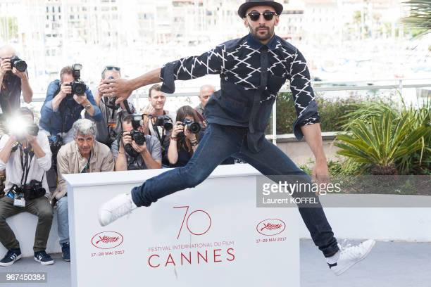 JR attend the 'Faces Places ' photocall during the 70th annual Cannes Film Festival at Palais des Festivals on May 19 2017 in Cannes France