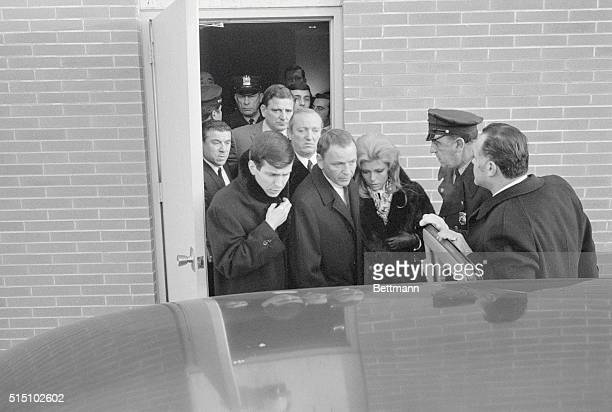 Attend Wake Cliffside Park New Jersey A subdued Frank Sinatra flanked by his son Frank Jr and daughter Nancy leaves Macagna Funeral Home here after...