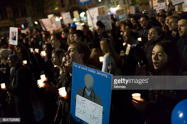 Attendants at a protest against changes to junior doctor contracts