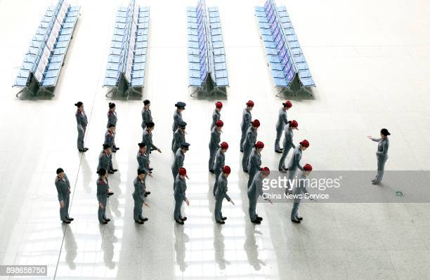 Attendants attend a training at Nanchang railroad section on December 25 2017 in Nanchang Jiangxi Province of China Train attendants practise...