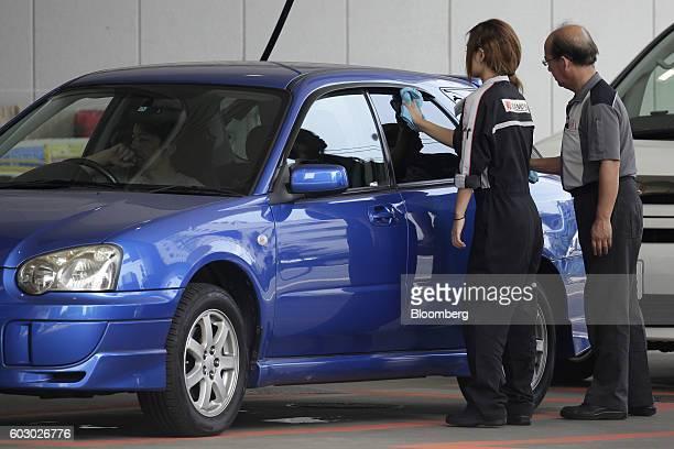 Attendants clean a customer's vehicle at an Idemitsu Kosan Co gasoline station in Tokyo Japan on Friday Aug 12 2016 At an Idemitsu shareholder...