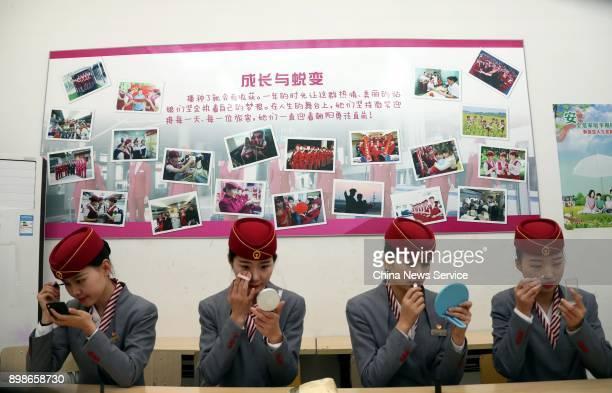 Attendants do touchups during a training at Nanchang railroad section on December 25 2017 in Nanchang Jiangxi Province of China Train attendants...