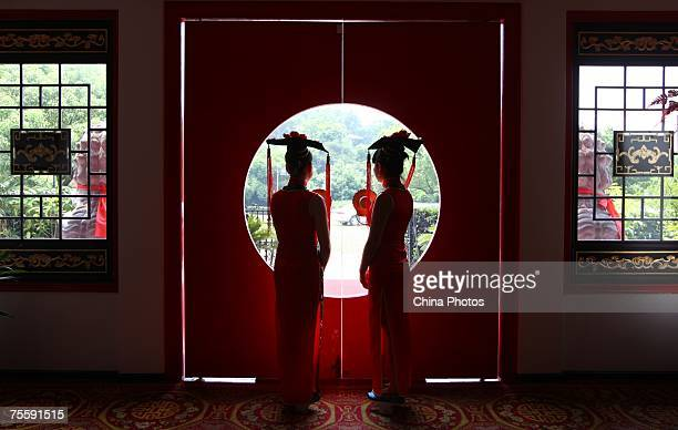Attendants dressed in costume of Qing Dynasty wait for customers at a luxury restaurant on July 22 2007 in Wenzhou of Zhejiang Province China...