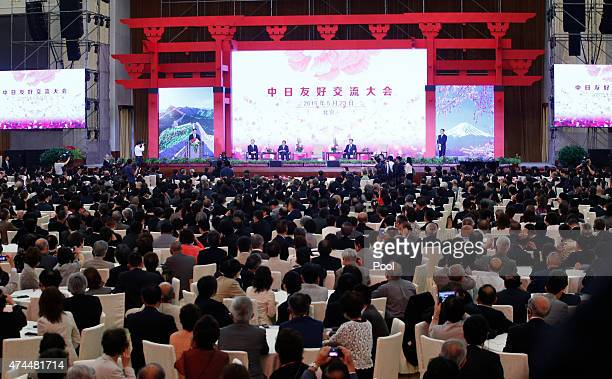 Attendants listen a speech by Chinese President Xi Jinping during the ChinaJapan friendship exchange meeting at the Great Hall of the People in...