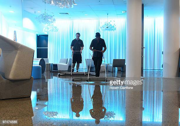 Attendants look to clear water from the players lounge at Rod Laver Arena as massive storms hit Melbourne city on March 6 2010 in Melbourne Australia...