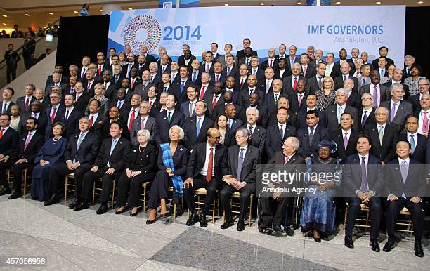Attendants of annual meetings of the World Bank and IMF have their family photo taken after the meeting in Washington United States on 11 October 2014