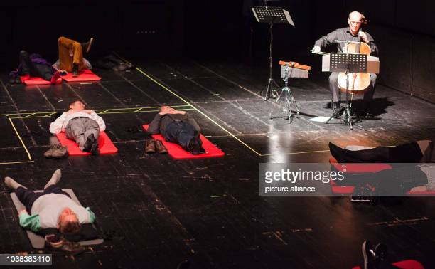 Attendants of the concert 'Hören im Liegen' enjoy works of Johann Sebastian Bach played by Francis Gouton in the Kammertheater in Stuttgart Germany...