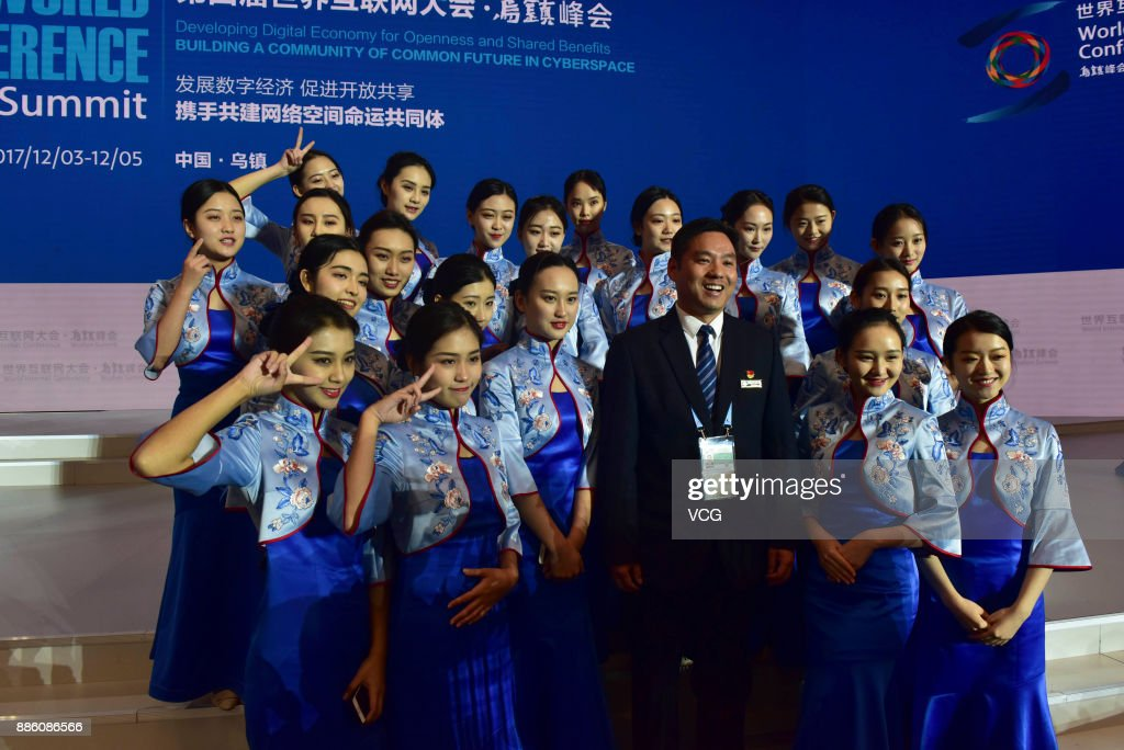 Attendants pose for photos after the closing ceremony of the 4th World Internet Conference on December 5, 2017 in Wuzhen, Zhejiang Province of China. The 4th World Internet Conference - Wuzhen Summit themed with 'Developing digital economy for openness and shared benefits -- building a community of common future in cyberspace.' is held from Dec 3 to 5 in Wuzhen of Zhejiang.