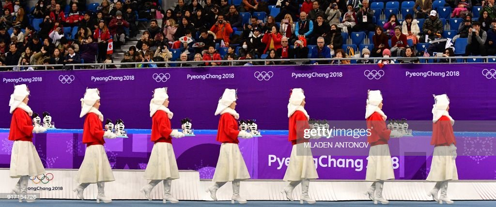 TOPSHOT - Attendants prepare to take part in the venue ceremony after the figure skating team event during the Pyeongchang 2018 Winter Olympic Games at the Gangneung Ice Arena in Gangneung on February 12, 2018. / AFP PHOTO / Mladen ANTONOV