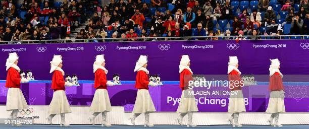 TOPSHOT Attendants prepare to take part in the venue ceremony after the figure skating team event during the Pyeongchang 2018 Winter Olympic Games at...