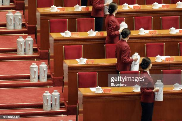 Attendants serve tea ahead of the opening of the 19th National Congress of the Communist Party of China at the Great Hall of the People in Beijing,...