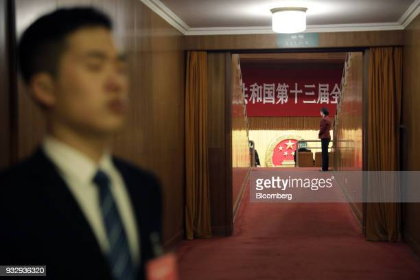 Attendants stand next to a door inside the Great Hall of the People ahead of a vote to confirm Xi Jinping a second fiveyear term as China's president...