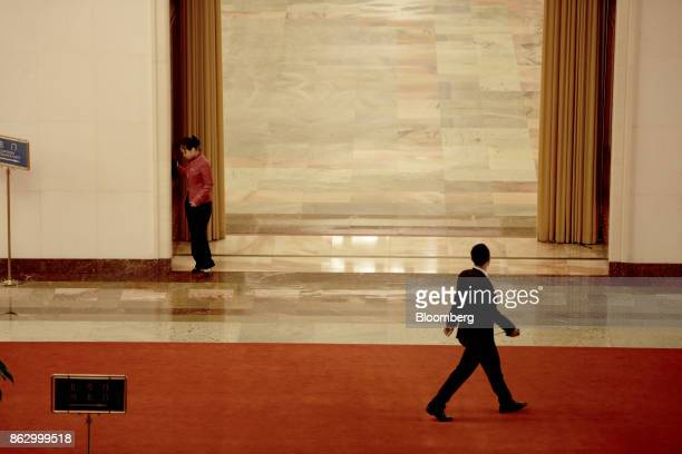 Attendants walk through a hallway in the Great Hall of the People during the 19th National Congress of the Communist Party of China in Beijing,...