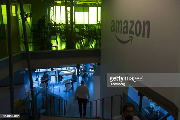 Attenddees walk inside of the Amazoncom Inc office after the company's product reveal launch event in downtown Seattle Washington US on Wednesday...