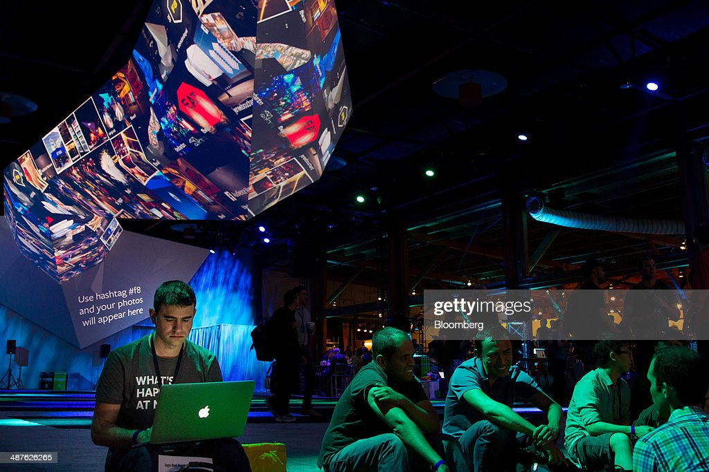 Attendee Adam Berlinsky-Schine, left, works on his computer during the Facebook F8 Developers Conference in San Francisco, California, U.S., on Wednesday, April 30, 2014. Facebook will offer software developers improved tools to create programs that run on any smartphone and a more streamlined experience for people to log into apps, including the option to sign in anonymously. Photographer: Erin Lubin/Bloomberg via Getty Images