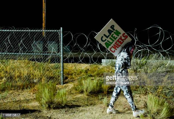 Attendee Ellie Urquhart walks past a security line as people gather to storm Area 51 at an entrance to the military facility near Rachel Nevada on...