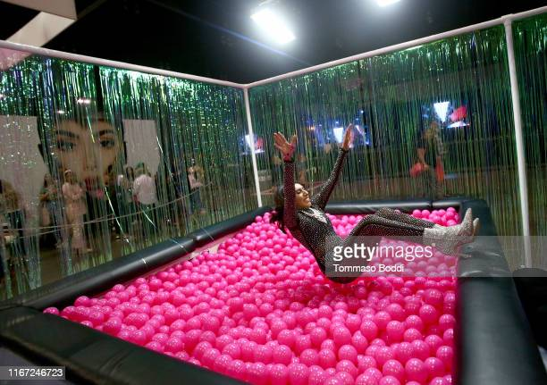 Attendee is seen in ball pit at Mugler booth during Beautycon Festival Los Angeles 2019 at Los Angeles Convention Center on August 10 2019 in Los...