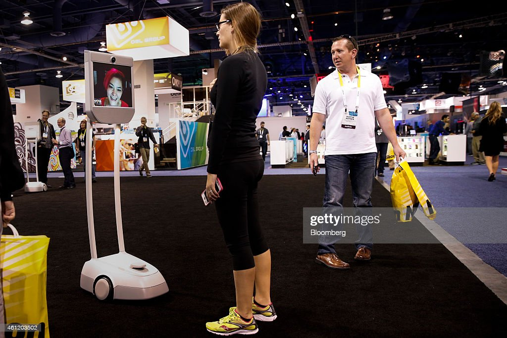 Attendee Jacqueline Sharp converses via Beam, a remote presence system manufactured by Suitable Technologies Inc., during the 2015 Consumer Electronics Show (CES) in Las Vegas, Nevada, U.S., on Thursday, Jan. 8, 2015. This year's CES will be packed with a wide array of gadgets such as drones, connected cars, a range of smart home technology designed to make everyday life more convenient and quantum dot televisions, which promise better color and lower electricity use in giant screens. Photographer: Patrick T. Fallon/Bloomberg via Getty Images