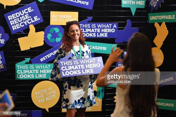 Attendee Kim Lundgren poses for a photo at a booth during the C40 Cities For Climate The Future Is Us kickoff event at San Francisco's City Hall on...
