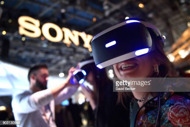 Attendee Kristen Sarah uses Sony's Playstation VR at the Sony booth during CES 2018 at the Las Vegas Convention Center on January 9, 2018 in Las...