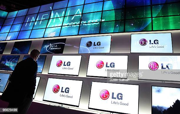 CES attendee looks at display of LG Infinia televisions at the 2010 International Consumer Electronics Show at the Las Vegas Hilton January 7 2010 in...