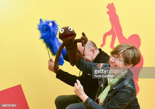 Attendee Rocio Ayuso practices puppeteering at the press preview of The Jim Henson Exhibition Imagination Unlimited at Skirball Cultural Center on...