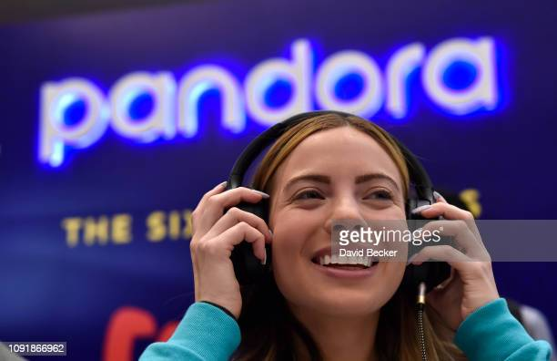 Attendee Stephanie Valdes listens to music samples at the Pandora booth during CES 2019 at the Aria Resort Casino on January 9 2019 in Las Vegas...
