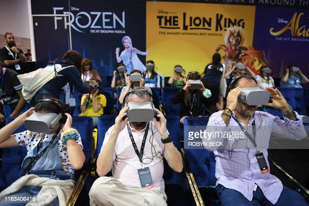 Attendee try the Disney on Broadway virtual reality experience at the D23 Expo billed as the largest Disney fan event in the world August 23 2019 at...
