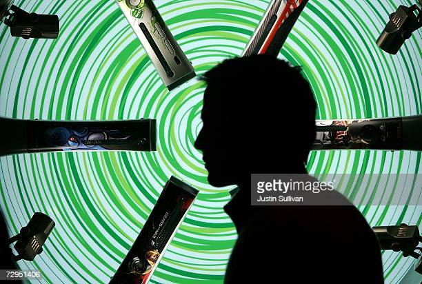 Attendee walks by a displaly of Microsoft XBox 360 gaming consoles at the Las Vegas Convention Center during the 2007 International Consumer...