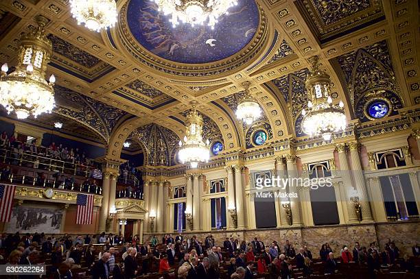 Attendees and electors pray before voting in the House of Representatives chamber of the Pennsylvania Capitol Building December 19 2016 in Harrisburg...