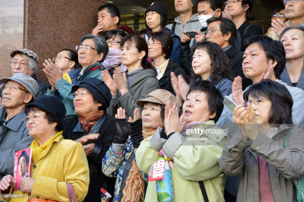 Attendees applaud as Shinzo Abe, Japans prime minister and president of the Liberal Democratic Party (LDP), not pictured, arrives at an election campaign rally in Sapporo, Hokkaido, on Sunday, Oct. 15, 2017. Abe looked set to retain his coalitions dominant position in parliament after the Oct. 22 general election, according to a series of large opinion surveys carried out by domestic media. Photographer: Eiji Ohashi/Bloomberg via Getty Images