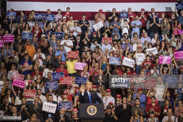 Attendees applaud as US President Donald Trump front speaks during a rally in WilkesBarre Pennsylvania US on Thursday Aug 2 2018 Trump tweeted...