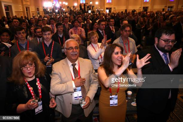 Attendees applaud following the singing of the national anthem during the Conservative Political Action Conference at the Gaylord National Resort and...