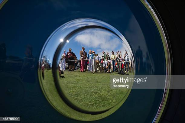 Attendees are reflected in the hubcap of a 1935 HispanoSuiza K6 Fernandez et Darrin Coupe Chauffeur during the 2014 Pebble Beach Concours d'Elegance...