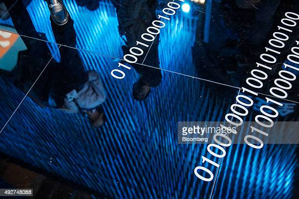 Attendees are reflected on the floor at the 2015 Computing Conference in Hangzhou China on Wednesday Oct 14 2015 Alibaba Group Holding Ltd's bet on...