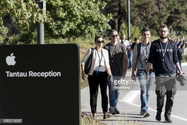 Attendees arrive ahead of an Apple Inc event at the Steve Jobs Theater in Cupertino California US on Wednesday Sept 12 2018 Apple will kick off a...