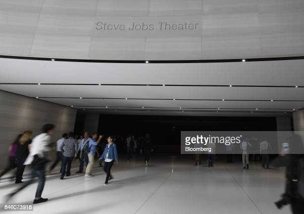 Attendees arrive ahead of an event at the Steve Jobs Theater in Cupertino California US on Tuesday Sept 12 2017 Apple plans to unveil three...