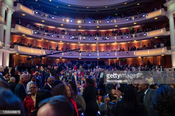 Attendees arrive ahead of the Democratic presidential debate in Charleston South Carolina US on Tuesday Feb 25 2020 Michael Bloomberg is trying for a...