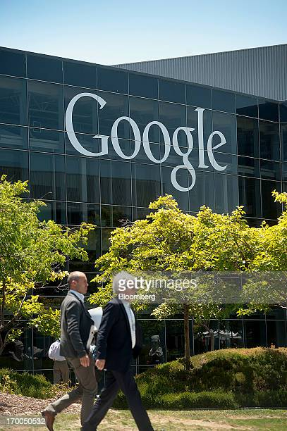 Attendees arrive at Google Inc's headquarters for the company's annual shareholders meeting in Mountain View California US on Thursday June 6 2013...