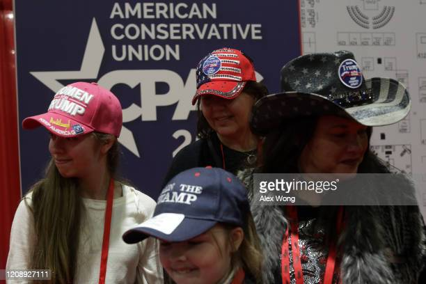 Attendees arrive at the annual Conservative Political Action Conference at Gaylord National Resort Convention Center February 26 2020 in National...