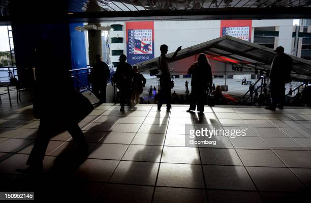 Attendees arrive at the Republican National Convention in Tampa, Florida, U.S., on Wednesday, Aug. 29, 2012. Representative Paul Ryan takes the stage...