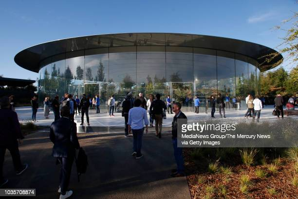 Attendees arrive at the Steve Jobs Theatre Wednesday Sept 12 for Apple's product launch in Cupertino Calif