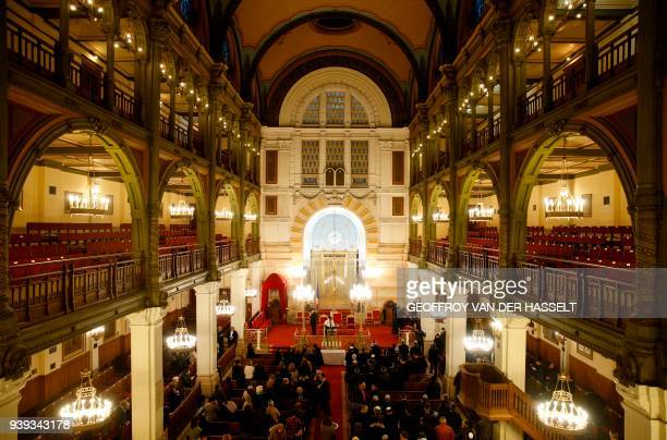 Attendees arrive at The Synagogue des Tournelles in Paris on March 28 for a service in memory of Mireille Knoll the 85yearold Jewish woman murdered...